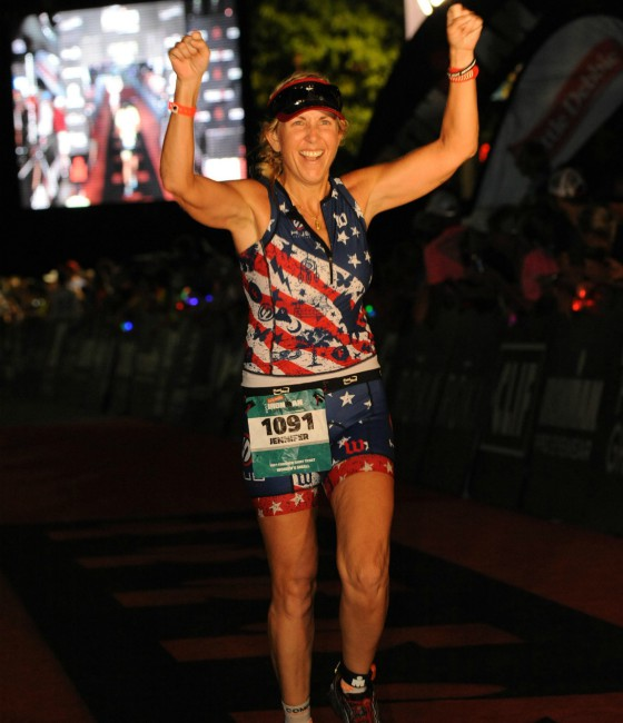 Jennifer at the finish line at IRONMAN Chattanooga.
