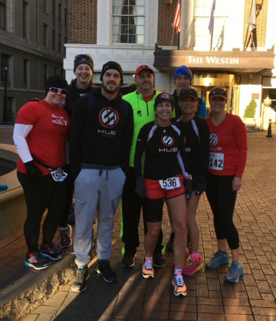 Team Hub group picture downtown greenville before a race.