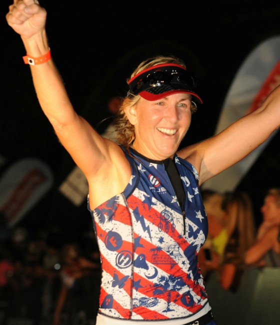 Jennifer after crossing the finish line at IRONMAN Chattanooga.