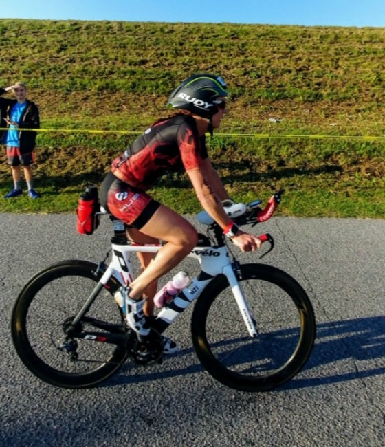 Team Hub member cycling in a race.